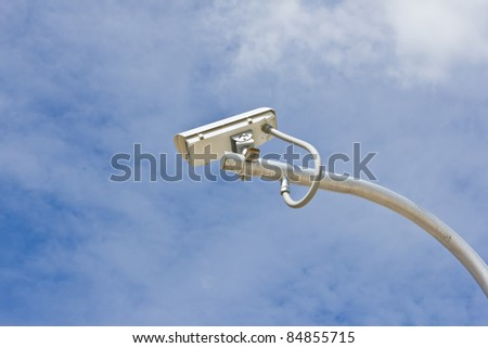 outdoor security cctv camera against blue sky - stock photo