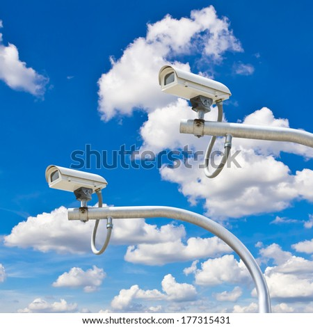 outdoor security cctv cameras against blue sky - stock photo