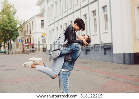 outdoor sensual fashion portrait of young couple in love, having fun, relaxed end end enjoy time together at urban city street, beautiful hipster couple, elegant trendy clothes, romantic atmosphere - stock photo