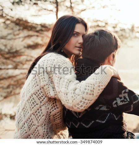 Outdoor sensual portrait of young couple in love posing in winter  - stock photo