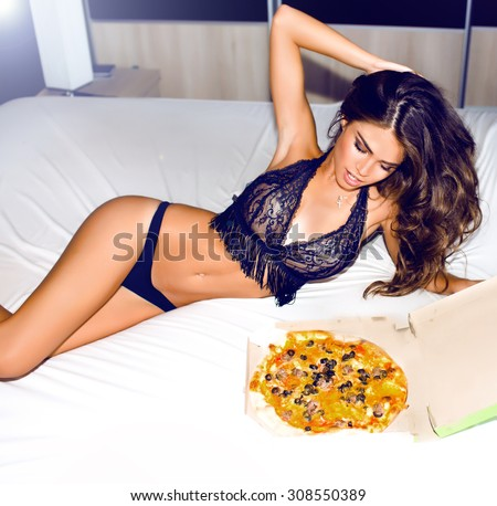 Outdoor Sexy Brunette woman holding tasty pizza with cheese.Woman order at home delivery and waiting for her friends,home party,pajama party,weekends,laughing,lifestyle portrait,no diet,hungry girl - stock photo