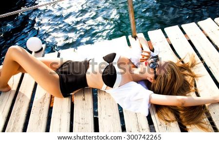 Outdoor Sexy Women wear Crop Deep V-Neck Hollow,Out Crochet,Knitted Bra Boho Beach Bikini Halter,amazing tan slim woman,Womens Bandage Push-up Bikini Set Padded Bra Triangl Swimsuit Swimwear.sunglass - stock photo