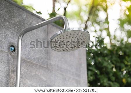 outdoor shower left side shower head beside the pool