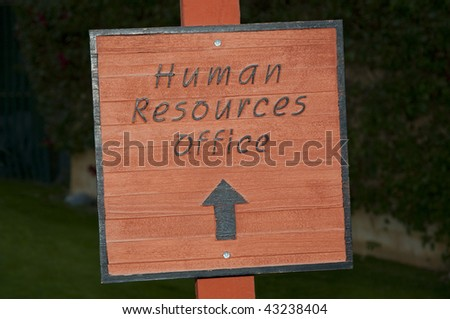 Outdoor sign pointing to Human Resources Offices - stock photo