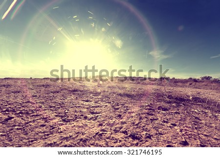 Outdoor soil floor background and sun in vintage style.Abstract ground background and sunset - stock photo