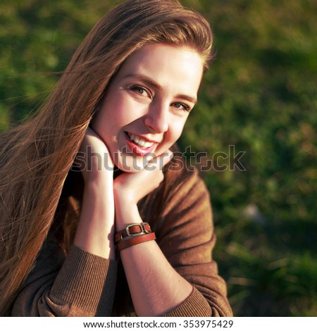 Outdoor spring portrait of sensual beautiful brunette smiling woman