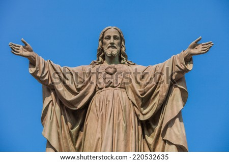 Outdoor Statue of Jesus with Open Arms - stock photo