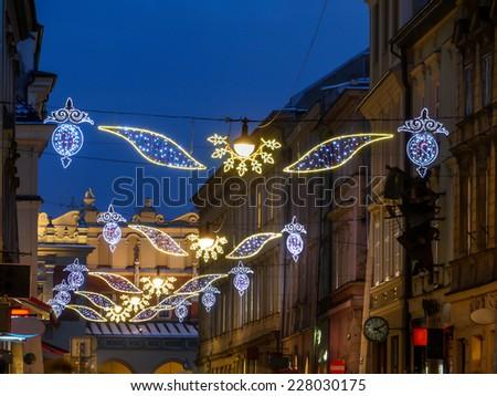 Outdoor street christmas illumination at night, Krakow, Poland - stock photo
