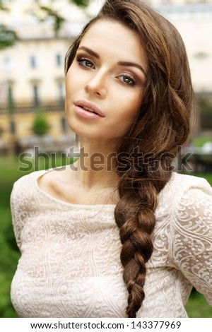outdoor summer portrait of young beautiful girl with braid - stock photo