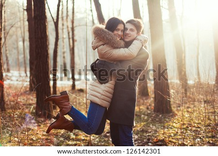 Outdoor summer portrait of young sensual couple. Boy hugs girl on the street in spring - stock photo