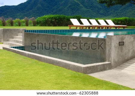 outdoor swimming pool in beautiful scenery - stock photo