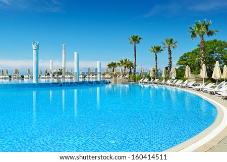 Outdoor swimming pool on the beach                                     - stock photo