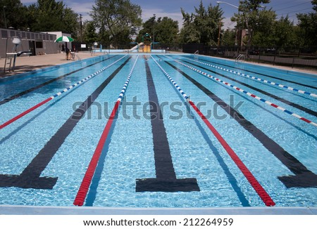 Outdoor Swimming Pool With Blue, White and Red Lap Lines - stock photo