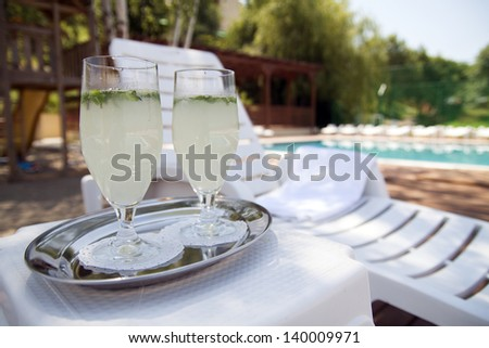 Outdoor swimming pool with fresh lemonade