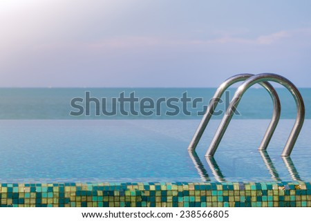 Outdoor Swimming pool with stair on Sunny Day - stock photo