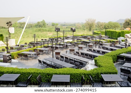 Outdoor Table and chairs in empty restaurant - stock photo