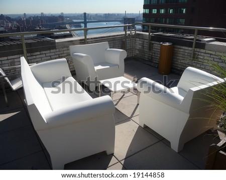 outdoor terrace overlooking the Brooklyn Bridge - stock photo