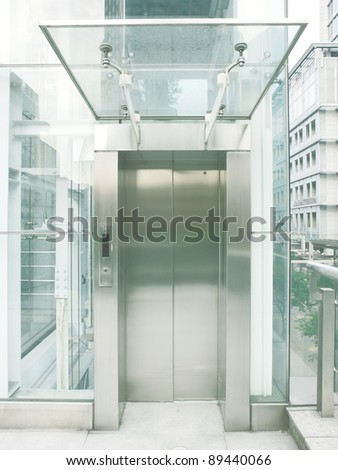 Outdoor transparent elevator - stock photo