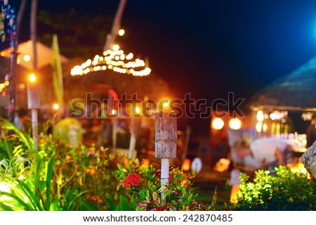outdoor tropical restaurant in night lights - stock photo