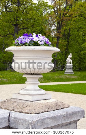 outdoor vase with flowers in the old manor park
