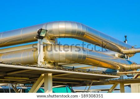 Outdoor ventilation system, on blue sky background - stock photo