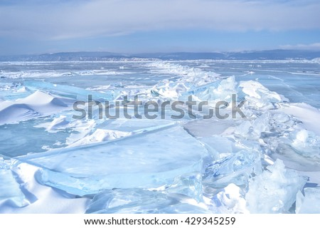 Outdoor view of ice blocks at frozen baikal lake in winter, Russia - stock photo