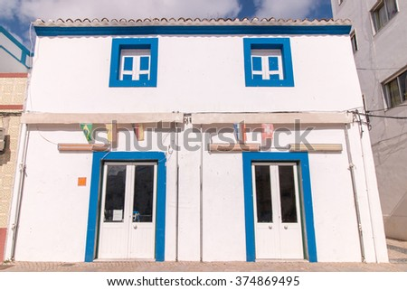 Outdoor view of the typical architecture of the cubist city of Olhao, Portugal. - stock photo