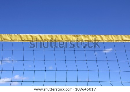 Outdoor volleyball net and blue sky with some clouds at summer. - stock photo