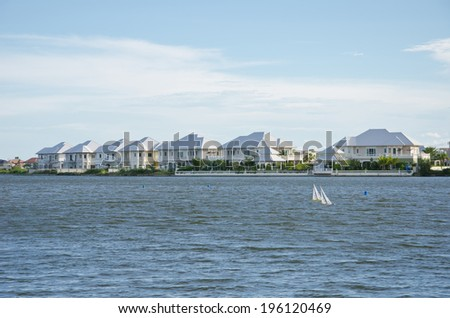 Outdoor waterfront homes, parks - stock photo