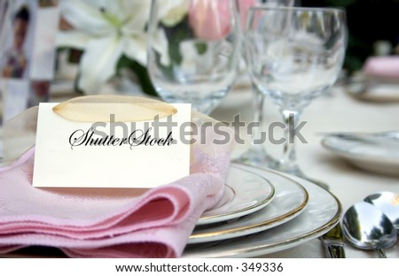 Outdoor wedding place setting with room for text on the place card - stock photo