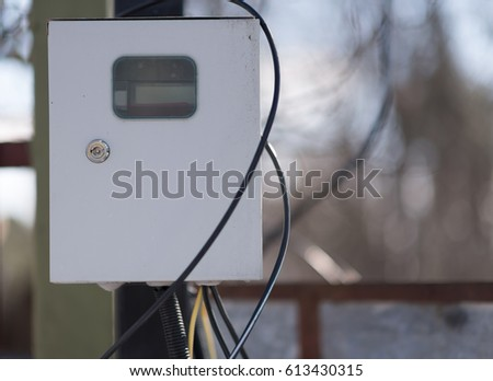 Outdoor White Electric Box With Steel Tube And Plug Black Background