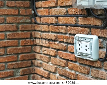 Outdoor White Electrical Outlet On Brick Wall With Copy Space