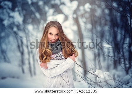 Outdoor winter portrait of young attractive woman. - stock photo