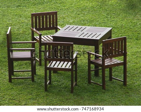 outdoor wooden chairs u0026 tables with four side seating arrangement on the grass lawn exterior outdoor chair39 chair