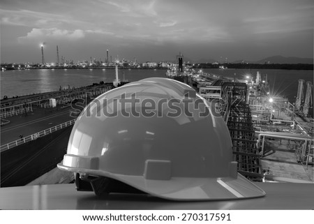 Outdoor work use Safety helmet for PORT petrochemical,Construction site black and white tone. - stock photo