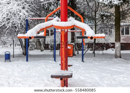 Outdoor workout gym with training gear covered with snow in winter