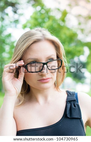 outdoor young woman with glasses smiling