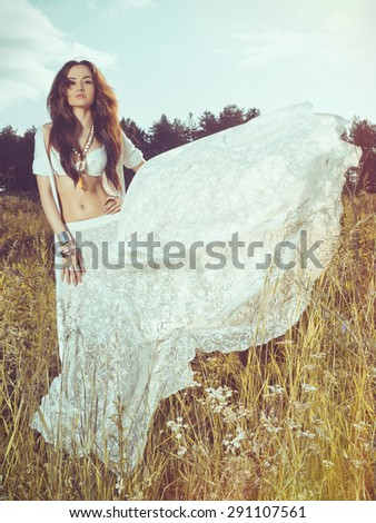 Outdoors fashion  photo of beautiful bohemian lady - stock photo