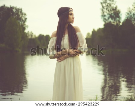 Outdoors fashion  photo of beautiful bohemian lady at river - stock photo