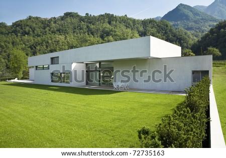 outdoors modern house with green garden - stock photo