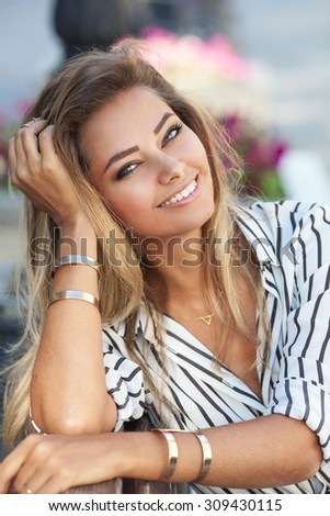 Outdoors portrait of a beautiful young girl - stock photo