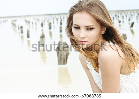 Outdoors portrait of a beautiful young woman - stock photo
