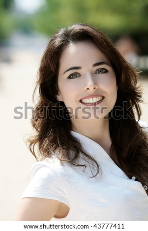 outdoors portrait of a expressive caucasian beautiful charming woma - stock photo