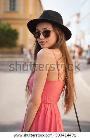 Outdoors portrait of a fashionable young brunette woman. - stock photo