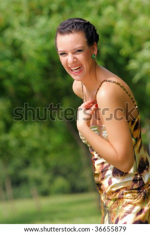 outdoors portrait of a happy smiling girl - stock photo