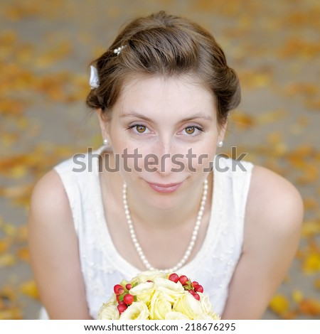 Outdoors portrait of beautiful young bride - stock photo