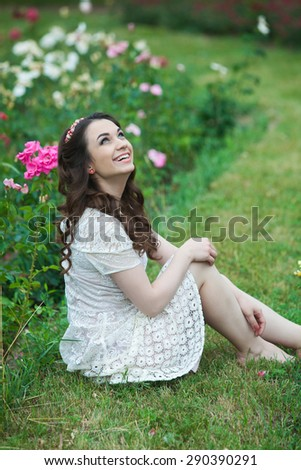 Outdoors portrait of beautiful young brunette girl. Beautiful girl smiling in city park.A smiling teenage girl outside.A beauty girl in nature - stock photo