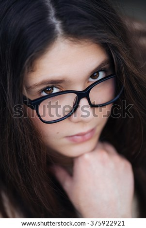 Outdoors portrait of beautiful young brunette girl. Focus is on eye. - stock photo