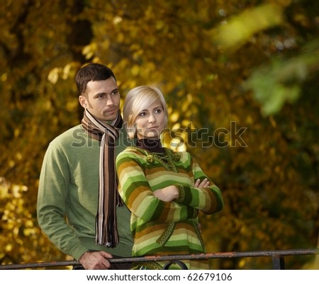 Outdoors portrait of couple in love, embracing autumn park.? - stock photo