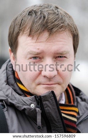 Outdoors portrait of courageous middle age man  - stock photo